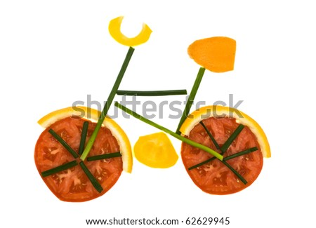 Colourful bike with tomato wheels isolated on white