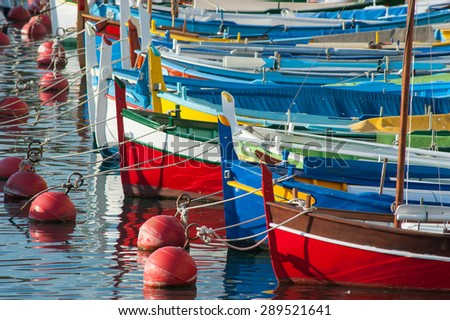 colourful boats docked in the port of nice in the south of France - stock photo