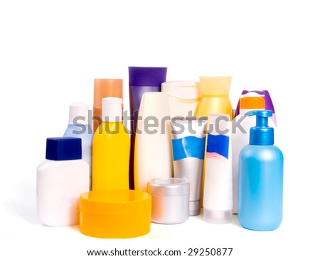 Colourful bottles of beauty products : conditioner, hand lotion, shampoo and shower gel. Isolated on a white background. - stock photo