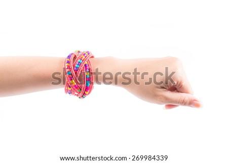 Colourful bracelets on female hand isolated on white background - stock photo