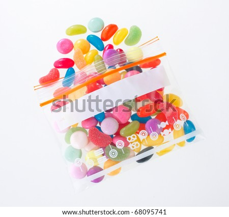 Colourful candy in the zipper bag isolated