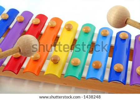 colourful child's glockenspiel with two wooden mallets, playing - stock photo