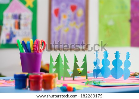 Colourful cutouts, pens and paints in a kindergarden - stock photo
