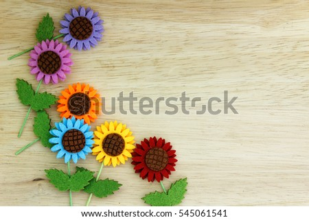 Colourful 2d doityourself paper flower on stock photo royalty free colourful 2d do it yourself paper flower on wooden background top view mightylinksfo Images