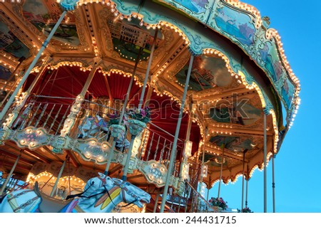 Colourful & Detailed Carousel ride at a theme park - stock photo