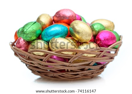 Colourful Easter eggs in a wicker basket