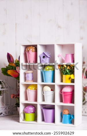 Colourful Eggs in miniature buckets and cans in shadowbox. Spring and Easter decor - stock photo