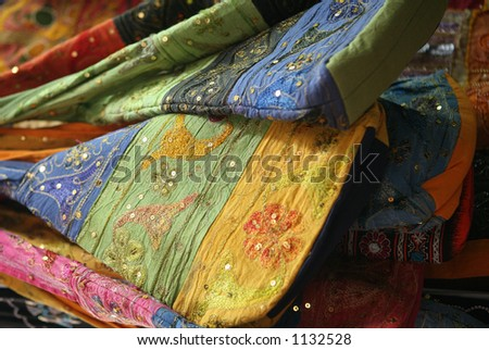 Colourful embroidered bags on sale in the Dubai Creek souq - stock photo