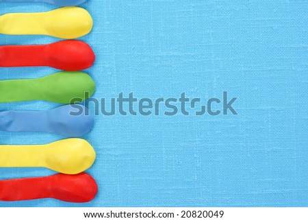 colourful empty balloons on blue background