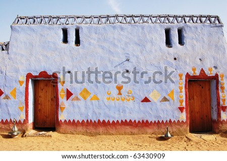 Colourful exterior wall of a Nubian house near the Nile River. - stock photo