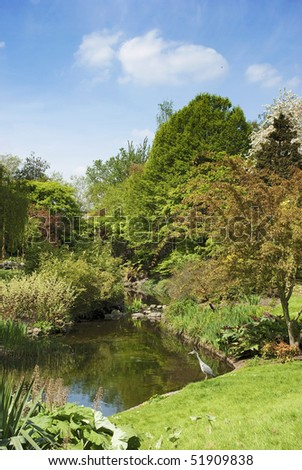 Colourful Garden with Heron in Hyde Park London - stock photo