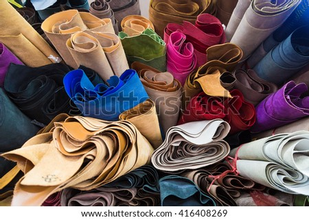 Colourful genuine cow leather on shelf in shop material used for shoe, bag, wallet etc product