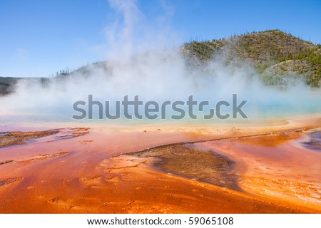 Colourful golden pool of bacteria in a volcanic run-off section of Yellowstone - stock photo