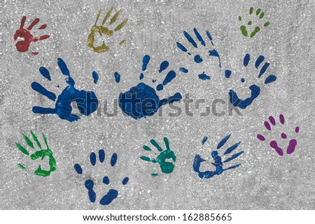 Colourful Handprints on a Wall - stock photo