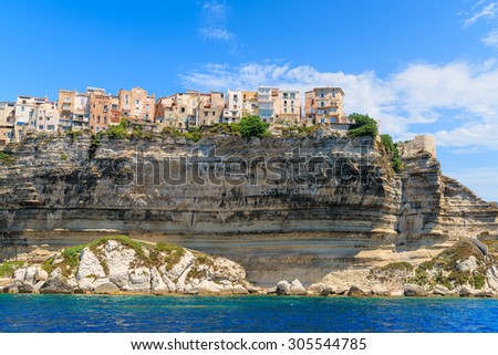Colourful houses of Bonifacio old town built on top of a cliff, Corsica island, France - stock photo