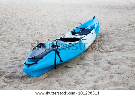 Colourful kayak on the beach - stock photo