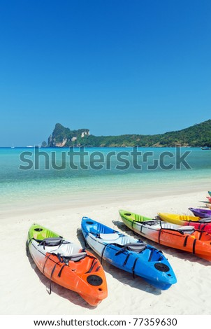 Colourful kayaks on the beach. Phi Phi island. - stock photo