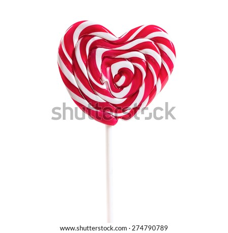 Colourful lollipop in the shape of a heart isolated on white background - stock photo