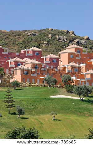 Colourful luxury houses and apartments on Duquesa golf course in Spain on the Costa del Sol - stock photo