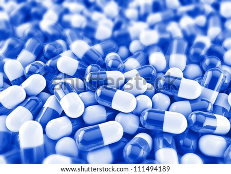 colourful medical pills background render in blue with photo blur - stock photo