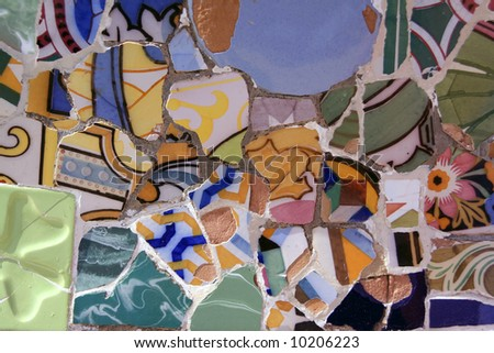 Colourful mosaic hand made of old broken tiles by Gaudi - stock photo