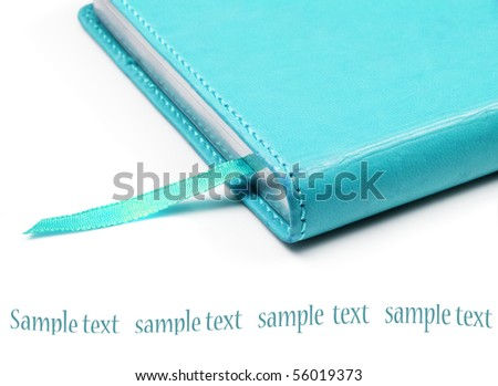 Colourful notebook on a pure white background with space for text - stock photo