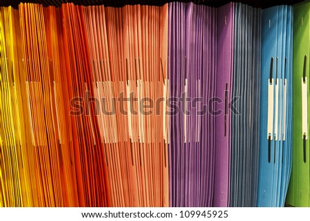 Colourful office background with folders - stock photo