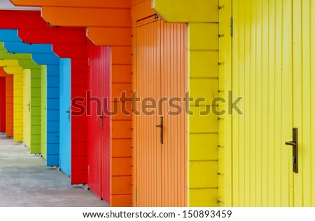colourful paint wooden Victorian beach hut at the seaside - stock photo