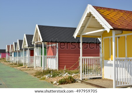 Colourful painted beach huts at Lancing (near Brighton) in West Sussex, England