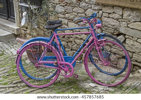 Colourful painted ladies' and men's bicycle - stock photo