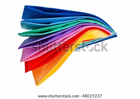 Colourful paper napkins isolated over white background. - stock photo
