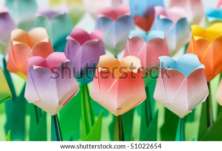 Colourful paper tulip field. Shallow depth of field. Focus on the front row. - stock photo
