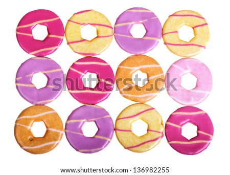 Colourful party biscuit background, isolated on white - stock photo