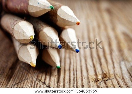 Colourful pencils made of real wood - stock photo