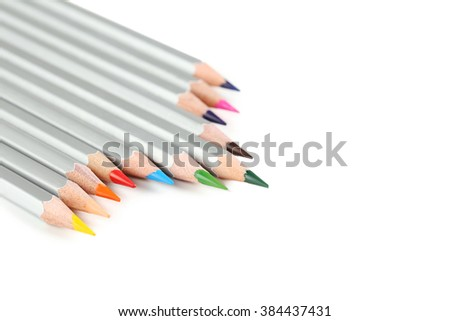 Colourful pencils on a white background, close up - stock photo