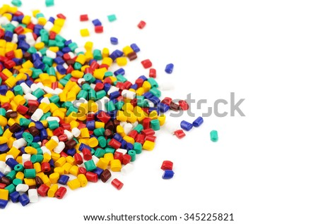 Colourful plastic granules isolated on a white background