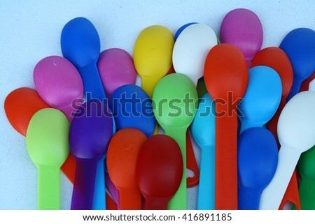 Colourful plastic spoons