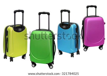 Colourful Polycarbonate Luggage on White Background - stock photo