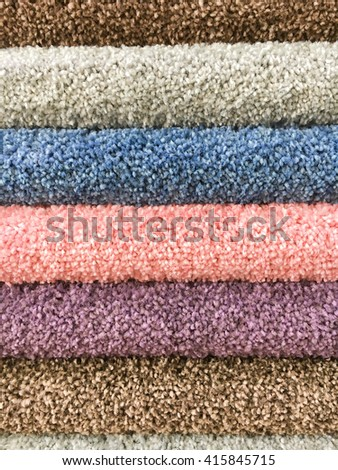 Colourful rolls of carpet as a background