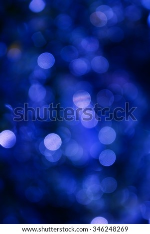 Colourful sparkle and blow Xmas bokeh  in dark blue light shining background