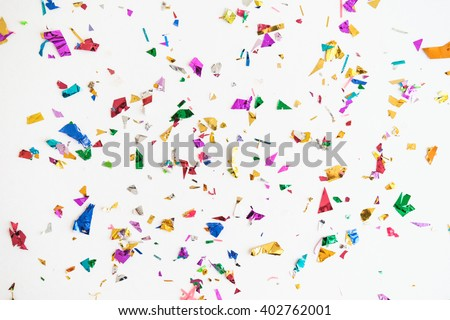 colourful sparlking confetti on white background - stock photo