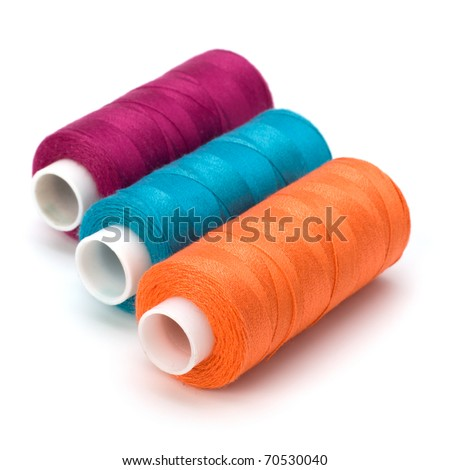 Colourful spools of thread isolated on white background - stock photo