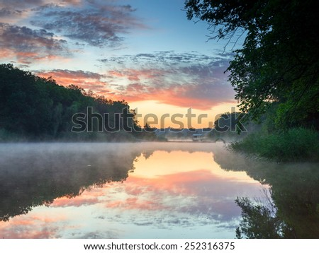 Colourful sunset on the fog river. Ukraine - stock photo