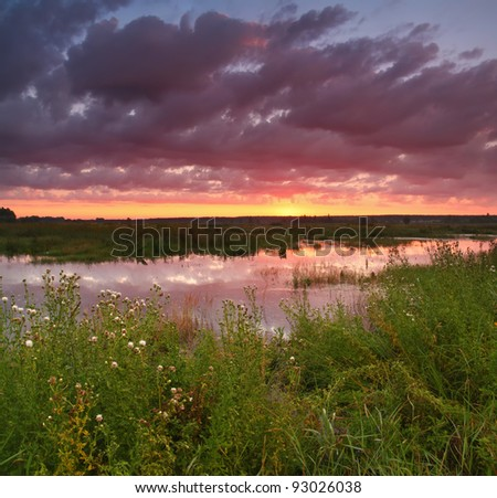 Colourful sunset on the river - stock photo