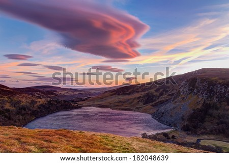 Colourful sunset over Lough Tay in Wicklow - stock photo