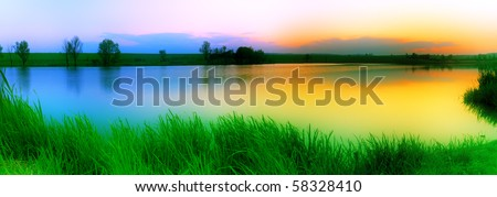Colourful sunset over the lake - stock photo