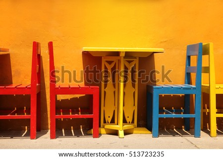 Colourful table & chairs ready for a street cafe or restaurant, Cartagena, Colombia.