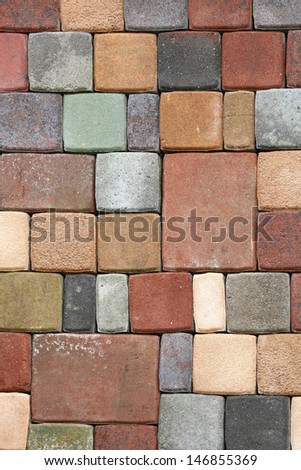 Colourful terracotta floor bricks in mosaic pattern