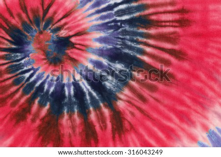 colourful tie dyed pattern on cotton fabric abstract background.
