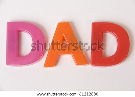 Colourful Toy Magnetic Alphabet Letters Spell Dad Isolated on White